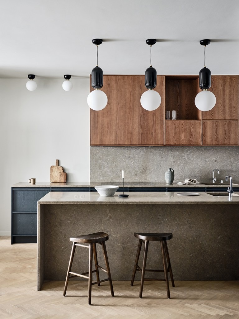 home trends of 2020. kitchen photo using both warm wood and grey stone